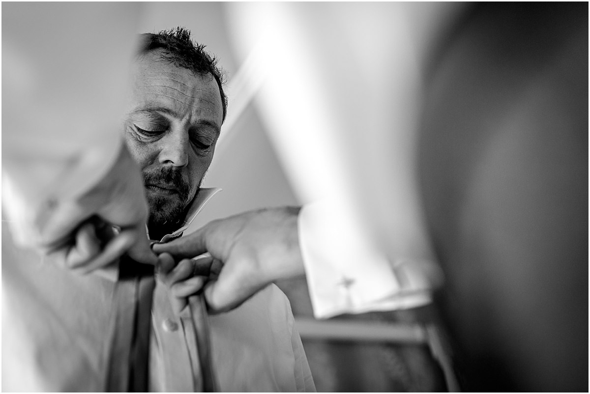 Southdowns Manor Wedding Photography best man adjusting tie