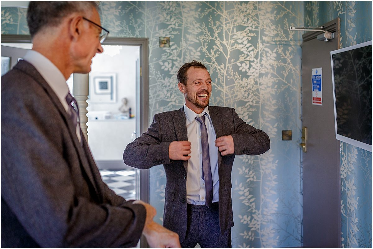 Southdowns Manor Wedding Photography best man in a suit