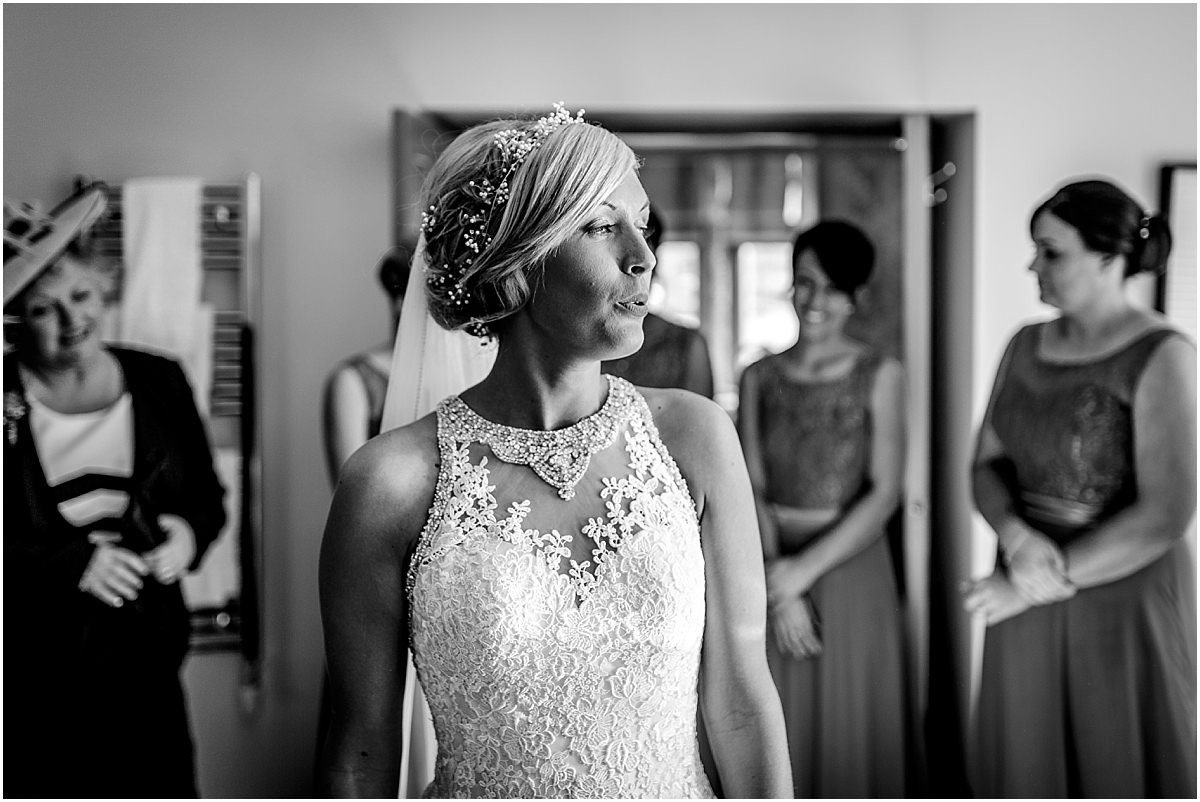 Southdowns Manor Wedding Photography bride looks out of the window