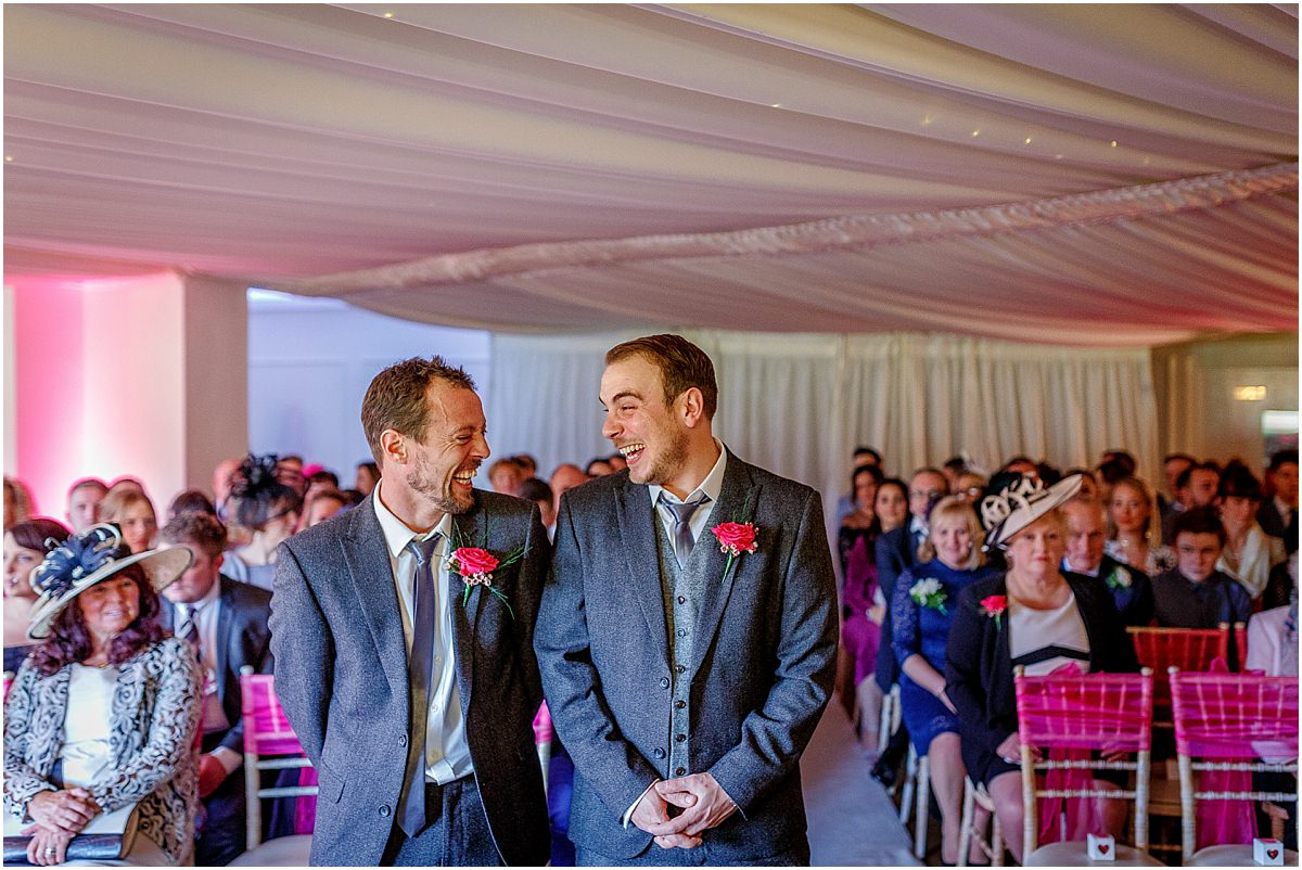 Southdowns Manor Wedding Photography groom and best man wait share a joke