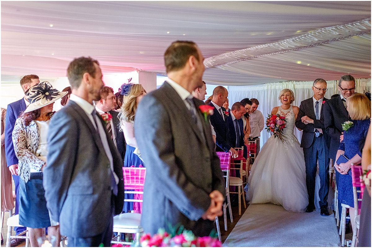 Southdowns Manor Wedding Photography bride walks down the aisle