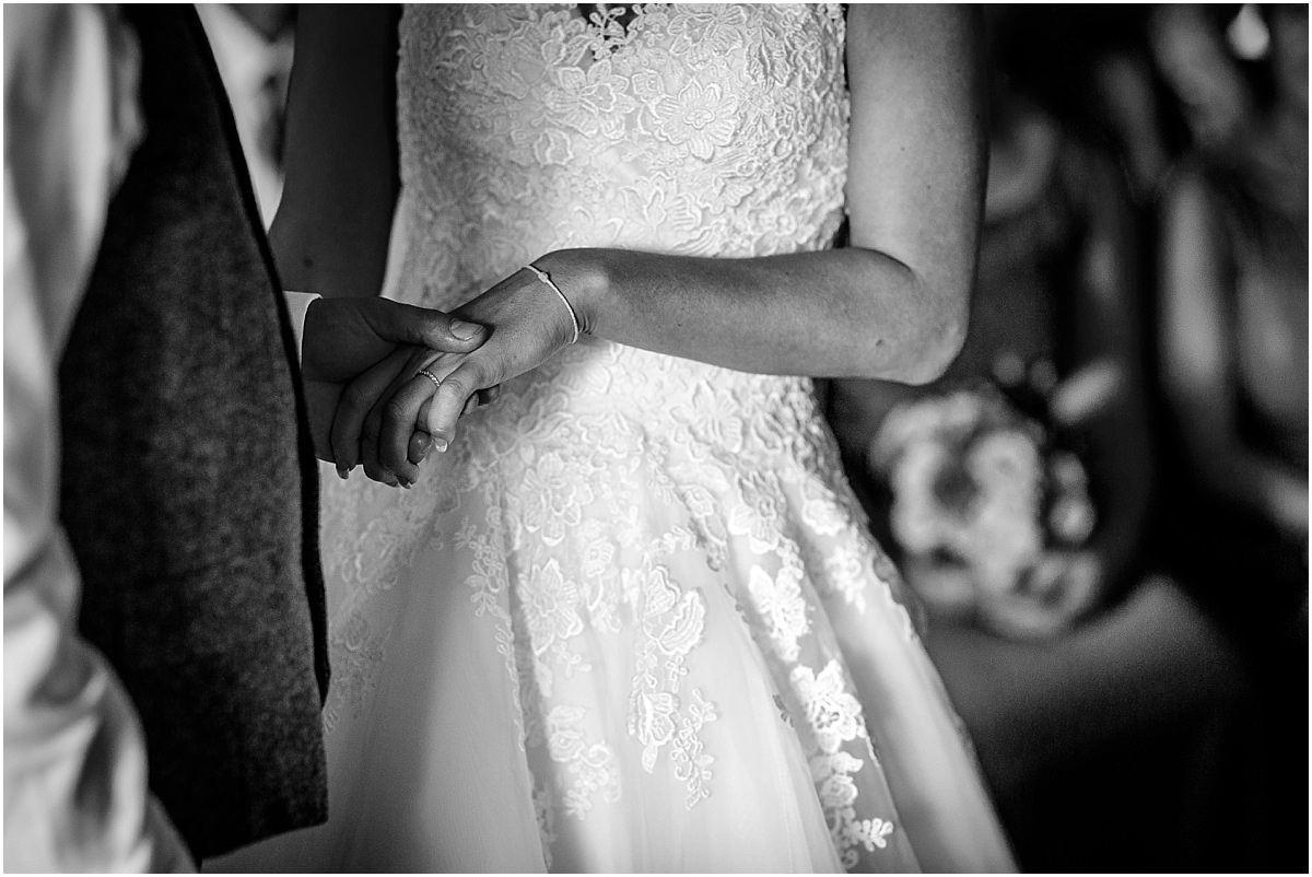 Southdowns Manor Wedding Photography bride and grooms hands touching