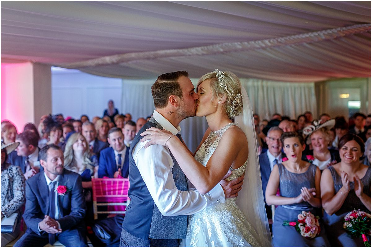 Southdowns Manor Wedding Photography bride and grooms first kiss
