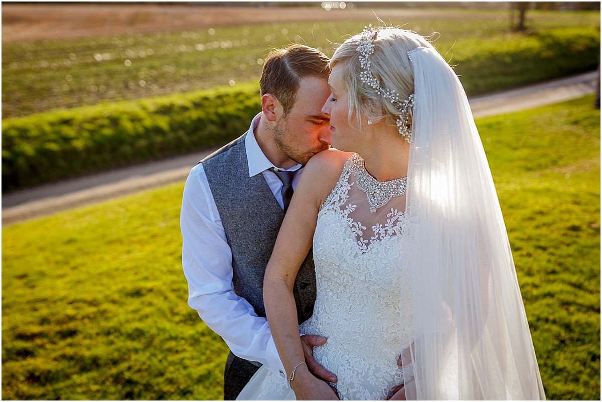 Southdowns Manor Wedding Photography bride and groom eyes closed