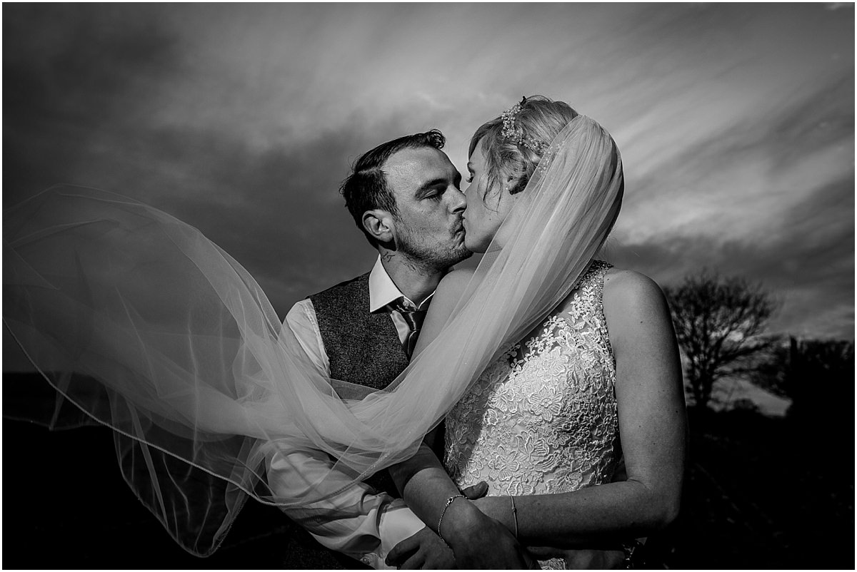 Southdowns Manor Wedding Photography bride and groom portrait kissing with there eyes closed