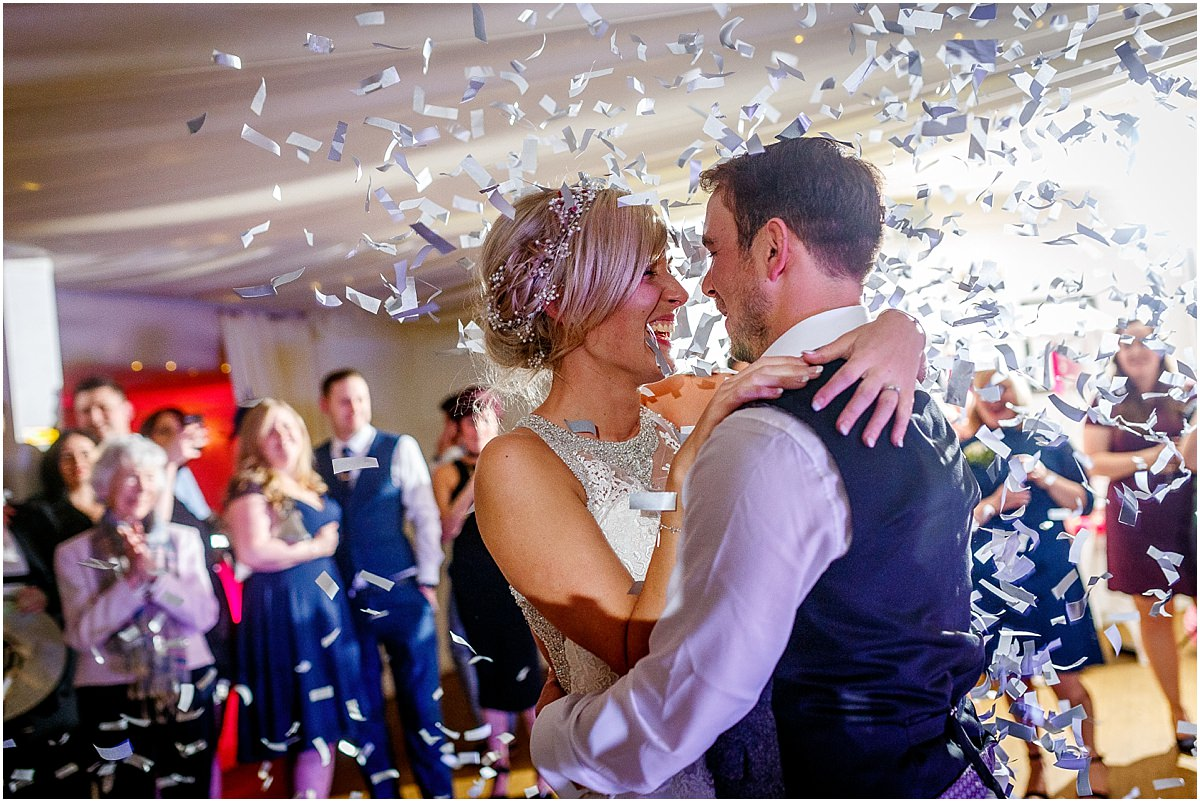 Southdowns Manor Wedding Photography bride and grooms first dance with confetti