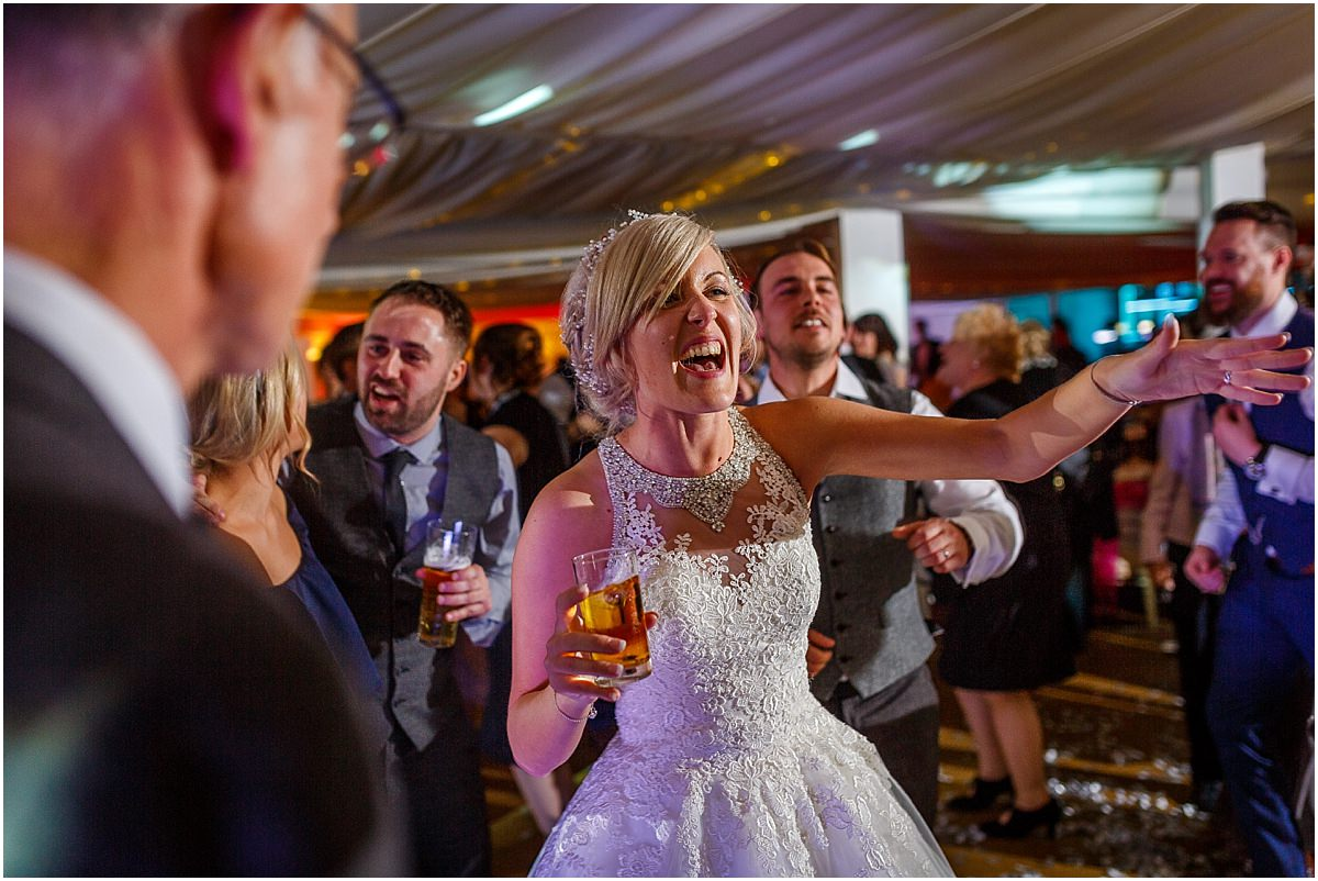 Southdowns Manor Wedding Photography bride dancing and laughing