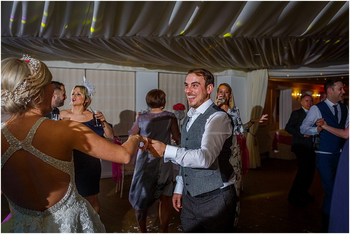 Southdowns Manor Wedding Photography groom dancing and laughing