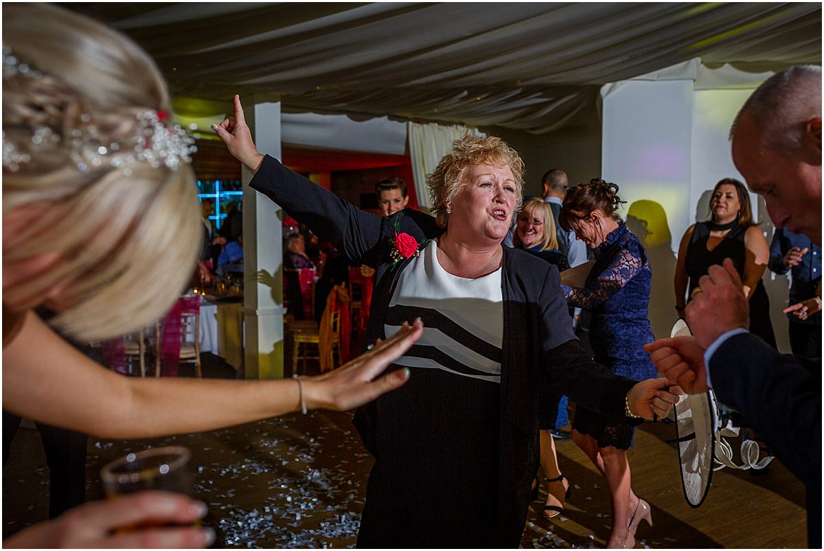 Southdowns Manor Wedding Photography mother of the bride dancing and laughing
