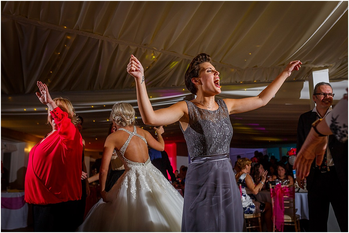 Southdowns Manor Wedding Photography sister of the bride dancing and laughing