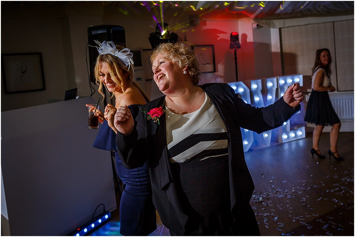 Southdowns Manor Wedding Photography wedding guests dancing and laughing