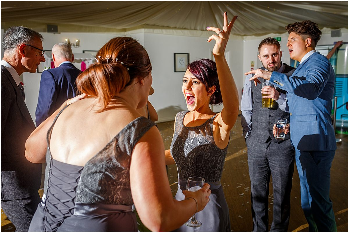 Southdowns Manor Wedding Photography mother of the bridesmaids dancing and laughing