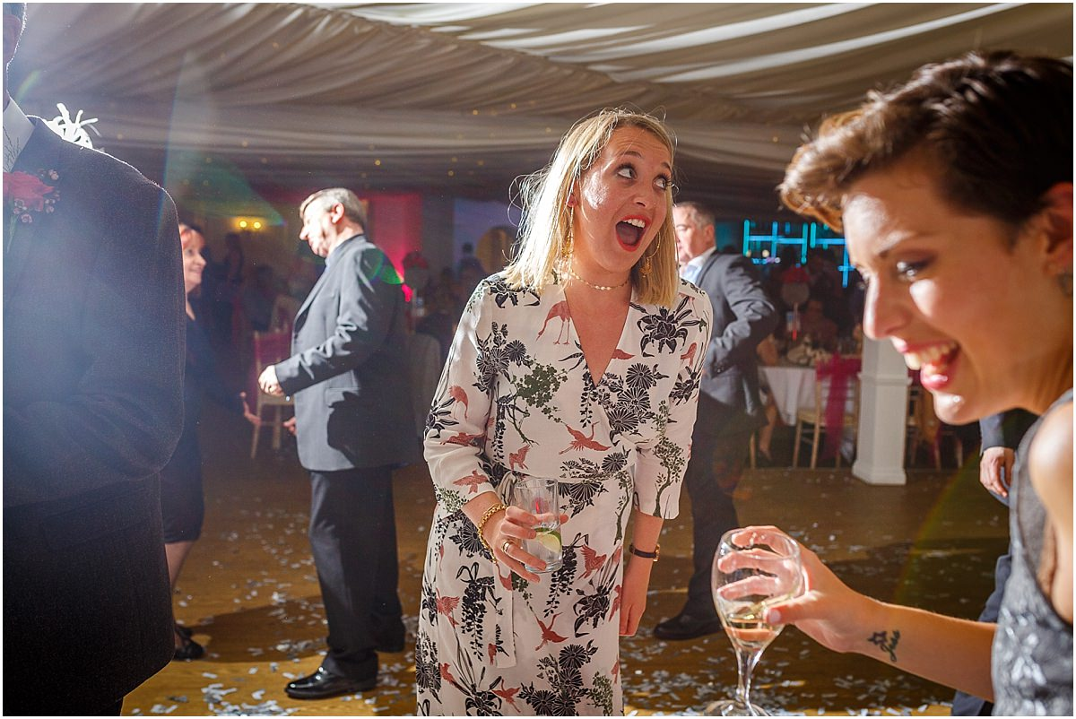 Southdowns Manor Wedding Photography wedding guest dancing and laughing