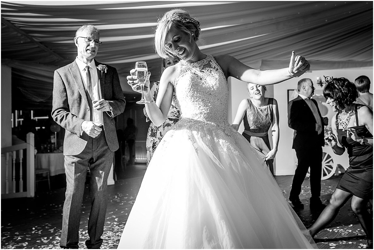 Southdowns Manor Wedding Photography bride drinking